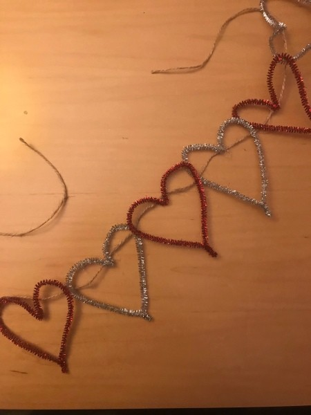 Making a Tinsel Pipe Cleaner Heart Garland - pipe cleaners attached to a length of twine