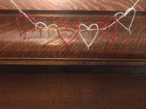 Making a Tinsel Pipe Cleaner Heart Garland - garland hanging