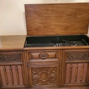 Value of a Magnavox Console Stereo - stereo cabinet with the top open