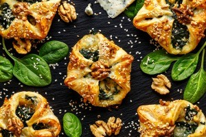 A selection of spinach pastry appetizers.