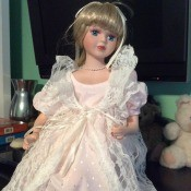 Value of a Heritage Signature Collection Doll - doll wearing a long pink dress with a long white lace over jacket