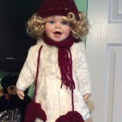 Value of a Heritage Signature Collection Doll - doll wearing a white fuzzy coat with a maroon hat, scarf, and mittens