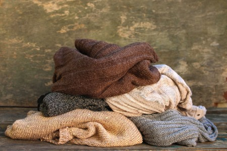 Recycle Old Sweaters into New Clothing - pile of sweaters