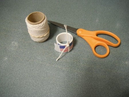 A roll of stamps tied with a string.