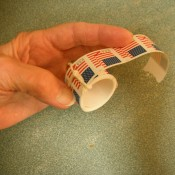 A roll of stamps tied with string.