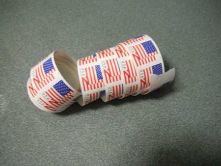 A roll of stamps coming undone.