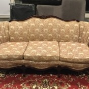 How Old Is My Sofa? - upholstered couch with dark wood trim