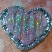 A heart made from cardboard, glitter and glue.