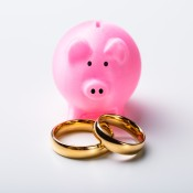 Piggy Bank with a set of wedding rings.