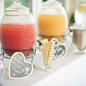 Canisters of different types of punch at a wedding.