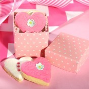 Heart shaped pink and white cookies in a pink favor box.