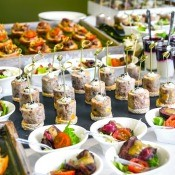 A table of catered food, for a party.