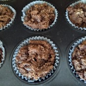 Chocolate Muffins in baking papers in tray