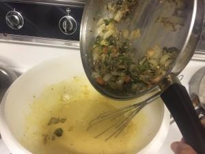 adding veggies to egg