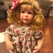 Value of a Danbury Mint Doll - blond child doll wearing a floral dress