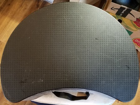 A curved lap desk.