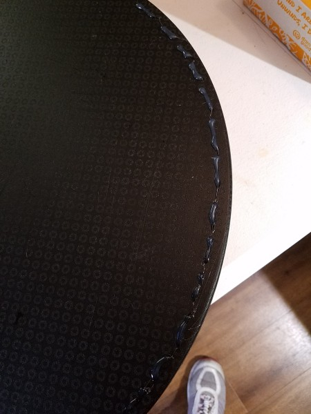 Hot glue added to the outer edge of the lap desk.