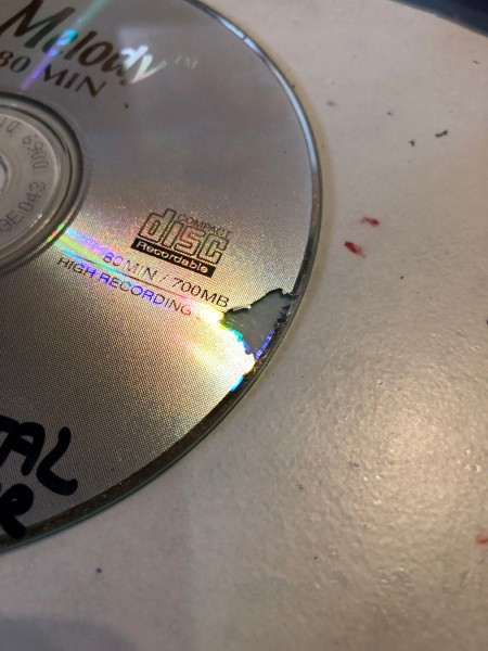 Making Feather Bookmarks from CDs - removing the CD label by scratching to start