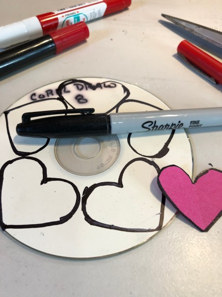 Recycled CD Mirrored Hearts - draw the hearts on the back side of a used CD and cut them out