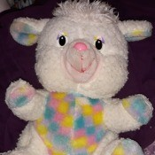 Identifying a Stuffed Toy -stuffed lamb with mulitcolored pastel fabric on ears, feet, and tummy