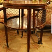 Value of a Round Mahogany Brandt End Table  - drum style end table with casters