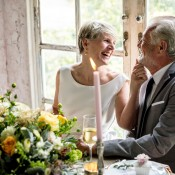 Couple sitting at a table after renewing their vows.