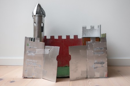 A cardboard castle painted silver.
