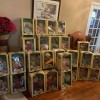 Selling Cabbage Patch Dolls - stacks of dolls in boxes