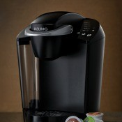 A Keurig coffee maker with some pods.
