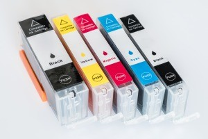 A collection of inkjet printer cartridges.