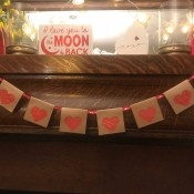 Simple Heart Garland - garland hanging on a mantel