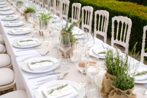 Wedding Table with live herbs in burlap as centerpieces.