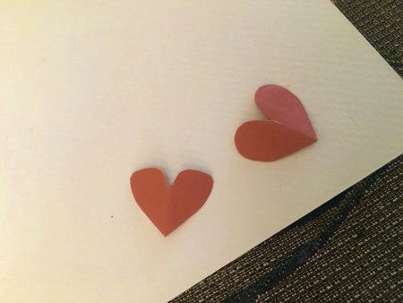 Making Hershey's Kiss Valentine Mice - cut out paper hearts for the ears