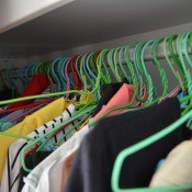 A closet full of clothes on hangers.