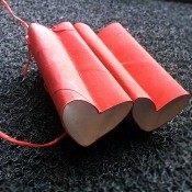 Heart-Shaped Toy Binoculars - red binoculars on dark background