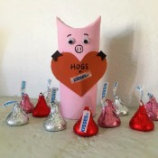 Hogs and Kisses Candy Holder - finished hog holder surrounded by red and silver wrapped Kisses