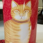 A tall slender round tip with a picture of a ginger cat on the front.