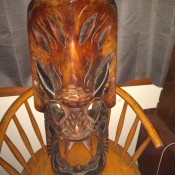 Identifying a Wooden Mask - mask on a chair