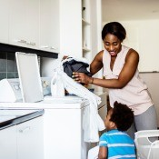 A mom and son doing laundry.