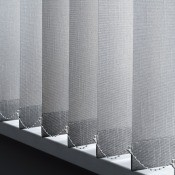Vertical blinds hanging in a window.