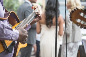 Guitarist playing at a wedding party.