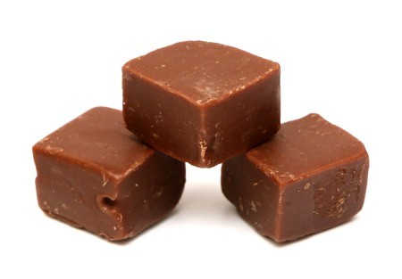 Squares of fudge on a white background.