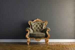 A vintage chair in a plain setting.