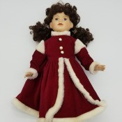 Identifying a Porcelain Doll - doll wearing a long red coat style dress with white fur trim