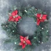 A Christmas wreath with red poinsettias.