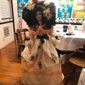 Value of an Ashley Belle Doll - doll in fancy dress with a peplum and a large fancy hat