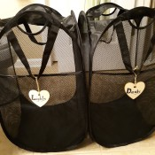 Two marked laundry hampers.