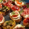 A platter of assorted crostini appetizers.