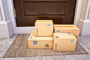 A pile of packages delivered to a home.
