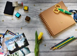 A scrapbook with photos and supplies.